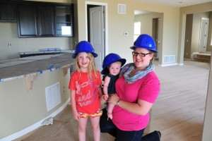 The Alderson family exploring their home during construction.